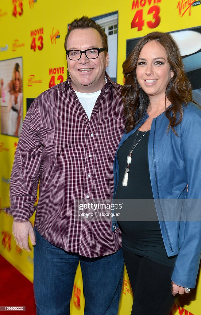 Actor <a gi-track='captionPersonalityLinkClicked' href=/galleries/search?phrase=Tom+Arnold&family=editorial&specificpeople=202506 ng-click='$event.stopPropagation()'>Tom Arnold</a> (L) and Ashley Groussman attend Relativity Media's 'Movie 43' Los Angeles Premiere held at the TCL Chinese Theatre on January 23, 2013 in Hollywood, California.
