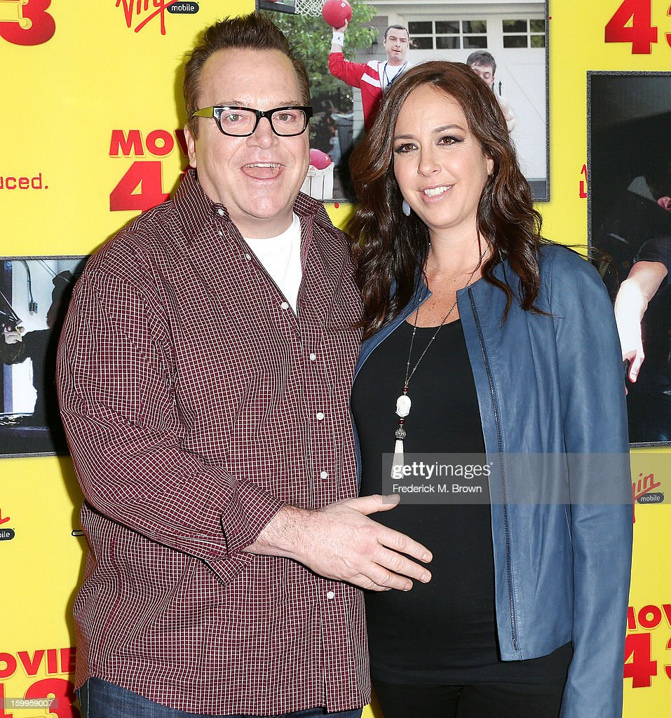 Actor <a gi-track='captionPersonalityLinkClicked' href=/galleries/search?phrase=Tom+Arnold&family=editorial&specificpeople=202506 ng-click='$event.stopPropagation()'>Tom Arnold</a> (L) and Ashley Groussman attend the Premiere Of Relativity Media's 'Movie 43' at the TCL Chinese Theatre on January 23, 2013 in Hollywood, California.