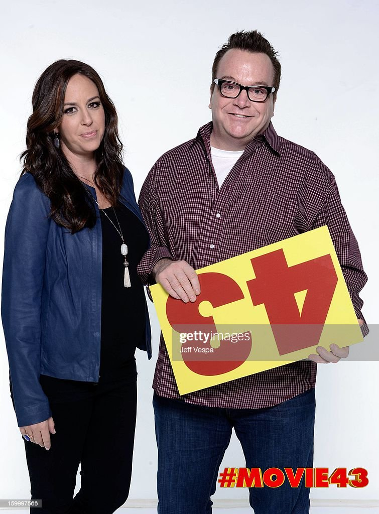 Actor <a gi-track='captionPersonalityLinkClicked' href=/galleries/search?phrase=Tom+Arnold&family=editorial&specificpeople=202506 ng-click='$event.stopPropagation()'>Tom Arnold</a> (R) and Ashley Groussman pose for a portrait during Relativity Media's 'Movie 43' Los Angeles premiere at TCL Chinese Theatre on January 23, 2013 in Hollywood, California.