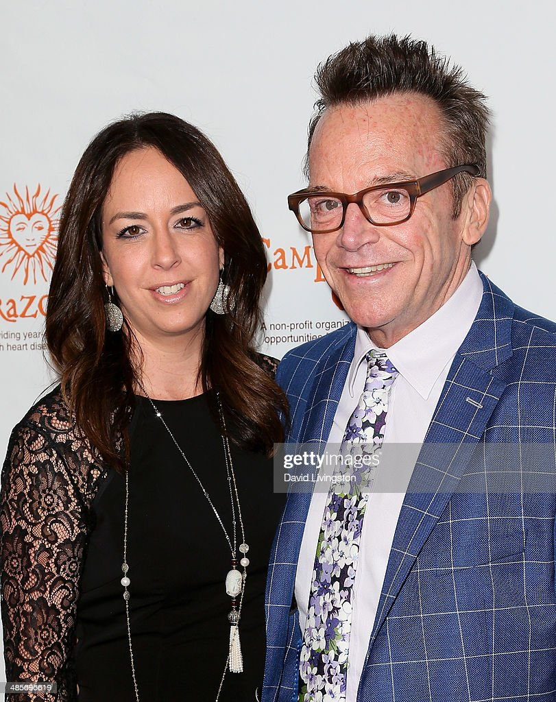 Actor <a gi-track='captionPersonalityLinkClicked' href=/galleries/search?phrase=Tom+Arnold&family=editorial&specificpeople=202506 ng-click='$event.stopPropagation()'>Tom Arnold</a> (R) and wife Ashley Groussman attend Camp del Corazon's 11th Annual Gala del Sol at the Ray Dolby Ballroom at Hollywood & Highland Center on April 19, 2014 in Hollywood, California.