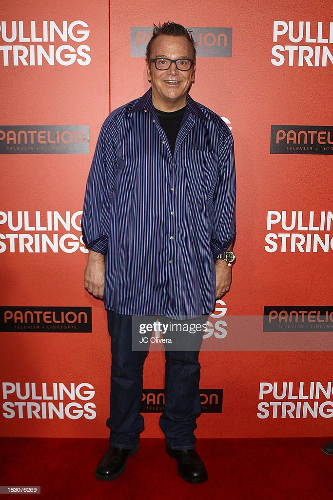 Actor <a gi-track='captionPersonalityLinkClicked' href=/galleries/search?phrase=Tom+Arnold&family=editorial&specificpeople=202506 ng-click='$event.stopPropagation()'>Tom Arnold</a> attends the Los Angeles Premiere of 'Pulling Strings' at Regal Cinemas L.A. Live on October 3, 2013 in Los Angeles, California.
