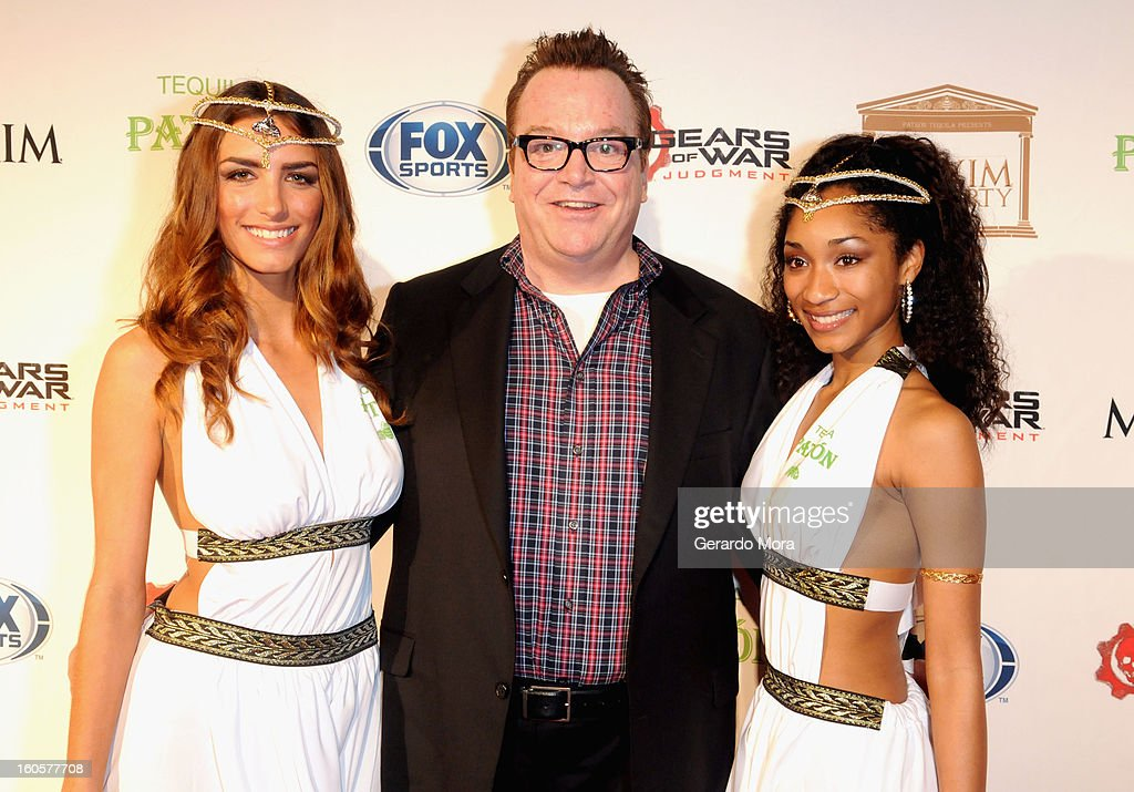 Actor <a gi-track='captionPersonalityLinkClicked' href=/galleries/search?phrase=Tom+Arnold&family=editorial&specificpeople=202506 ng-click='$event.stopPropagation()'>Tom Arnold</a> (C) attends The Maxim Party With 'Gears of War: Judgment' For XBOX 360, FOX Sports & Starter Presented by Patron Tequila at Second Line Warehouse on February 1, 2013 in New Orleans, Louisiana.
