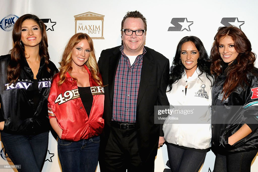 Actor <a gi-track='captionPersonalityLinkClicked' href=/galleries/search?phrase=Tom+Arnold&family=editorial&specificpeople=202506 ng-click='$event.stopPropagation()'>Tom Arnold</a> (C) poses on the Starter Red Carpet at the Maxim Party during Super Bowl XLVII at Second Line Warehouse on February 2, 2013 in New Orleans, Louisiana.