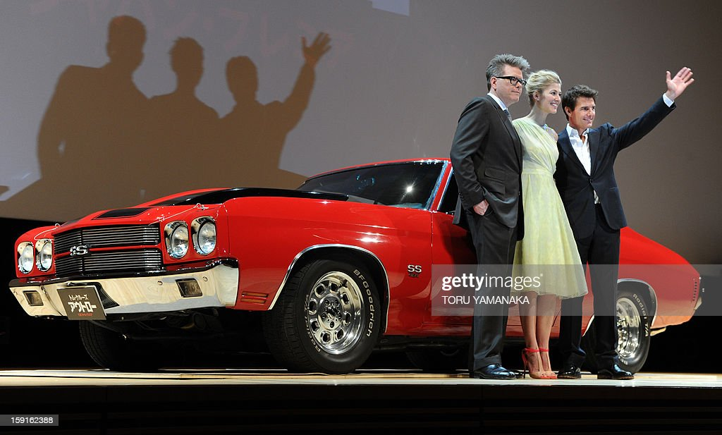 US actor Tom Cruise (R), actress Rosamund Pike (C) and director Christopher McQuarrie (L) pose beside a Chevrolet Chevelle SS, which is the same model used in their latest film, before the Japan Premiere of their latest movie, 'Jack Reacher' in Tokyo on January 9, 2013. The film will be shown nation wide from Feburary 1. AFP PHOTO/Toru YAMANAKA