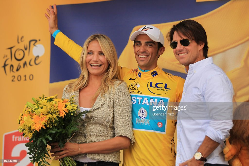 Actor Tom Cruise and actress Cameron Diaz stand on the podium with cyclist Alberto Contador after he was presented the yellow jersey at the...