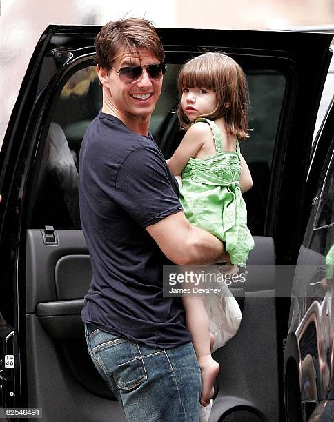 Actor Tom Cruise and his daughter Suri Cruise walk on the streets of Manhattan August 25 2008 in New York City