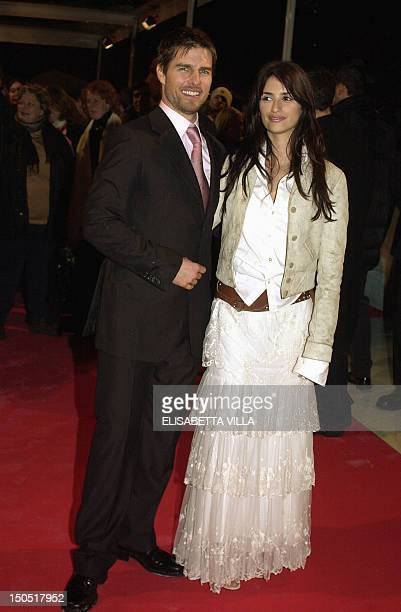 US actor Tom Cruise and his girlfriend actress Penelope Cruz pose before the premiere of their film 'Vanilla Sky' in Rome 24 January 2002 AFP PHOTO...