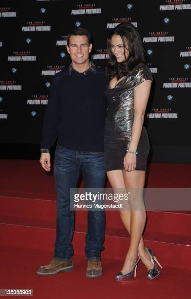 Actor Tom Cruise and Paula Patton attend the 'Mission Impossible Ghost Protocol' Premiere at the BMW Welt on December 9 2011 in Munich Germany