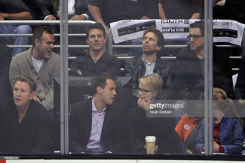 Actor Tom Cruise and producer Jerry Bruckheimer watch the game between the Los Angeles Kings and the San Jose Sharks in Game Five of the Western Conference Semifinals during the 2013 NHL Stanley Cup Playoffs at Staples Center on May 23, 2013 in Los Angeles, California.