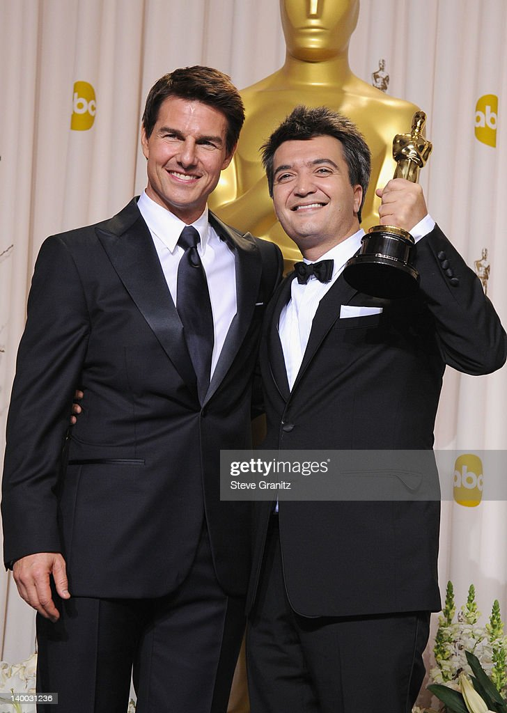 Actor Tom Cruise and producer Thomas Langmann pose in the press room at the 84th Annual Academy Awards held at the Hollywood Highland Center on...