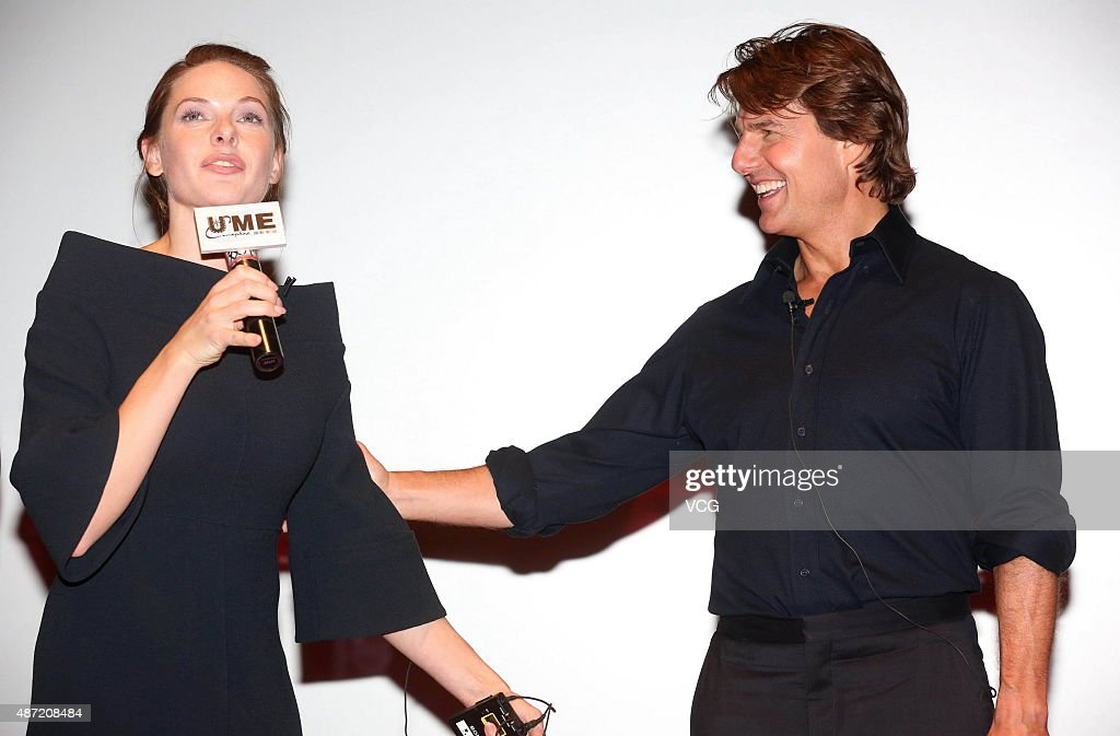 Actor tom cruise and swedish actress rebecca ferguson attend the
