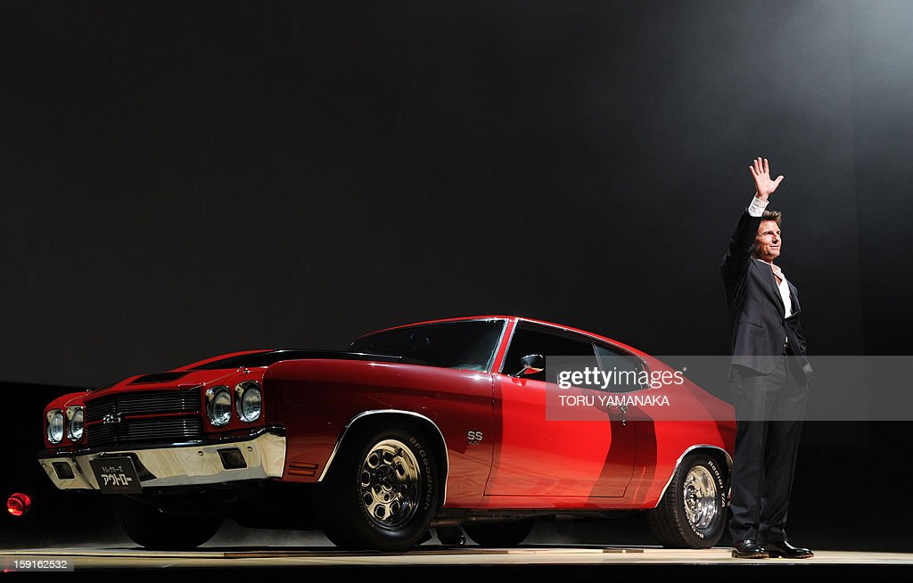 US actor Tom Cruise appears with a Chevrolet Chevelle SS, which is the same model used in his latest film, in front of Japanese fans before the Japan Premiere of his latest movie, 'Jack Reacher' in Tokyo on January 9, 2013. The film will be shown nation wide from Feburary 1. AFP PHOTO/Toru YAMANAKA