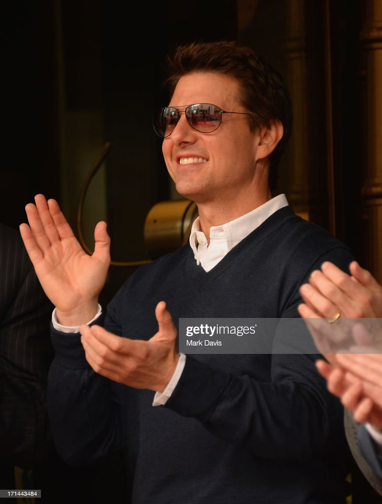 Actor <a gi-track='captionPersonalityLinkClicked' href=/galleries/search?phrase=Tom+Cruise&family=editorial&specificpeople=156405 ng-click='$event.stopPropagation()'>Tom Cruise</a> attends as Jerry Bruckheimer is honored on the Hollywood Walk Of Fame on June 24, 2013 in Hollywood, California.