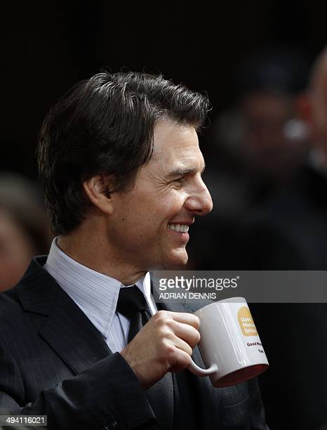 US actor Tom Cruise has a hot drink as he arrives for the World Premiere of the film 'Edge of Tomorrow' at the BFI IMAX cinema in London on May 28...