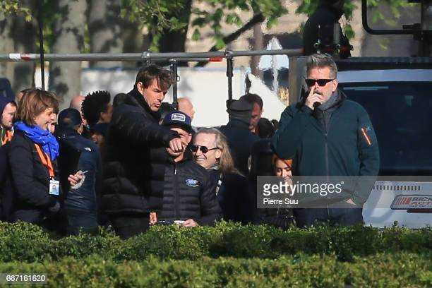 Actor Tom Cruise is seen talking to director Christopher Mc Quarrie on set for 'MissionImpossible 6 Gemini' on April 11 2017 in Paris France