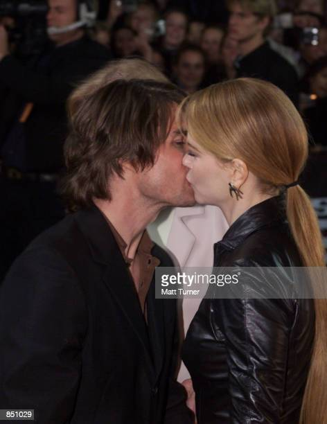 Actor Tom Cruise kisses his wife Nicole Kidman at the Sydney premiere of 'Mission Impossible 2' May 30 2000 at Fox Studios in Australia Cruise and...