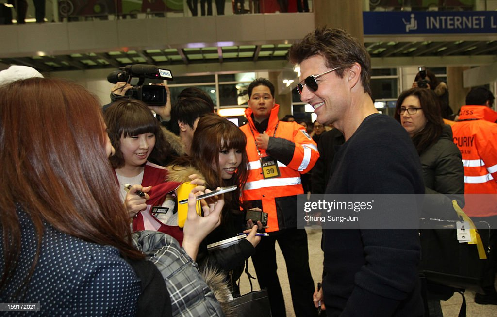Actor Tom Cruise meets fans as he arrives at Incheon International Airport on January 9, 2013 in Incheon, South Korea.