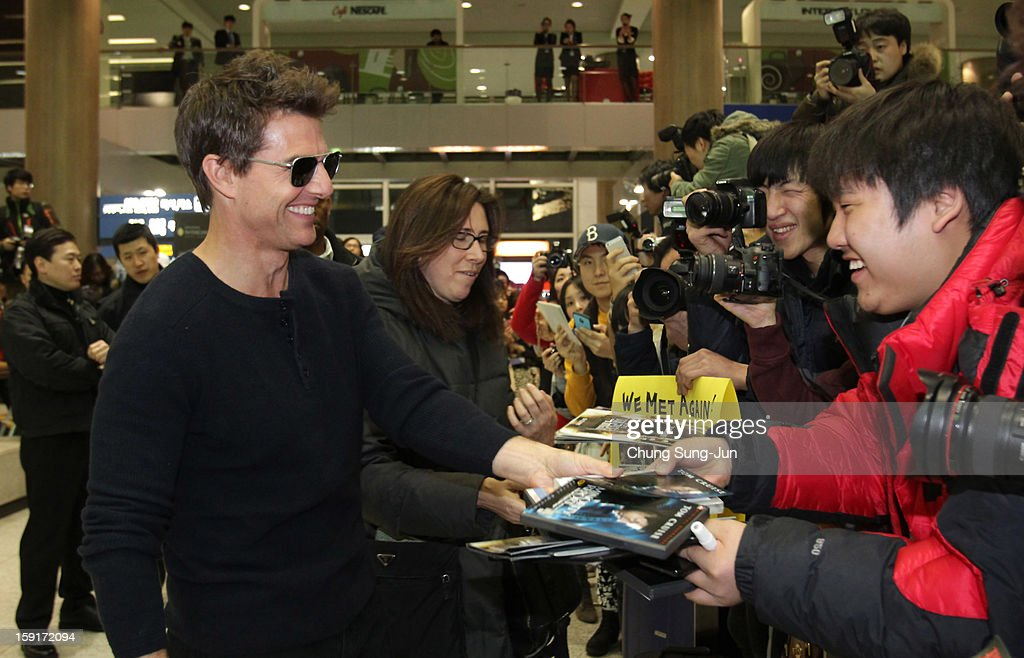 Actor <a gi-track='captionPersonalityLinkClicked' href=/galleries/search?phrase=Tom+Cruise&family=editorial&specificpeople=156405 ng-click='$event.stopPropagation()'>Tom Cruise</a> meets fans as he arrives at Incheon International Airport on January 9, 2013 in Incheon, South Korea.