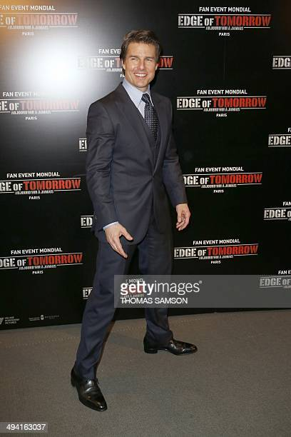US actor Tom Cruise poses at the premiere of the film 'Edge of Tomorrow' in Paris on May 28 2014 AFP PHOTO / THOMAS SAMSON