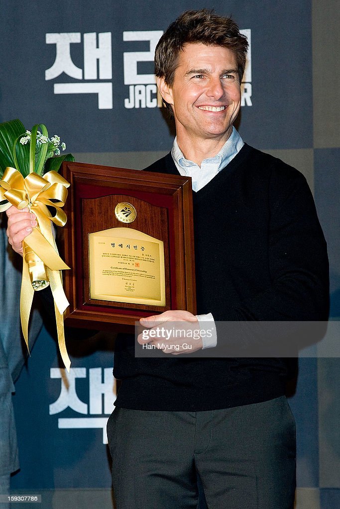 Actor Tom Cruise poses for media after receive an certificate honorary citizenship of the Busan City by Busan City mayor, Huh Nam-Shik during the 'Jack Reacher' Fan Screening at Busan Cinema Center on January 10, 2013 in Busan, South Korea. The film will open on January 17 in South Korea.