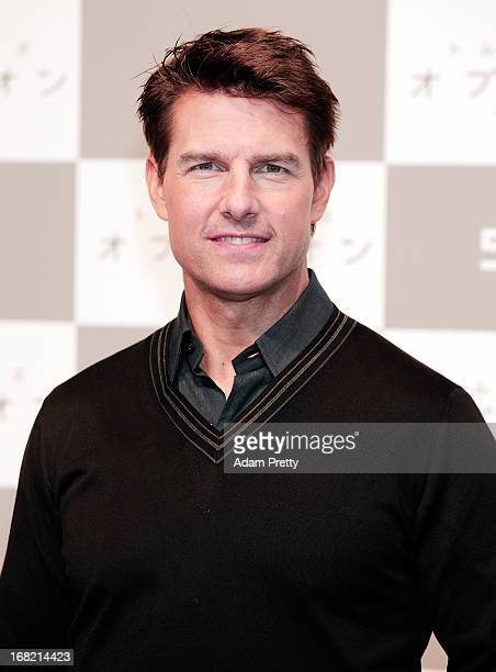 Actor Tom Cruise poses for photographers before attending the 'Oblivion' press conference at Ritz Carlton Tokyo on May 7 2013 in Tokyo Japan
