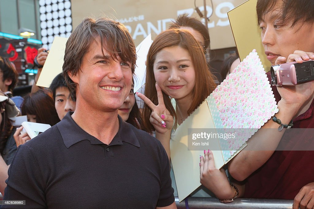 Actor Tom Cruise poses for photos with fans during the Japan Premiere of 'Mission: Impossible - Rogue Nation' at the Toho Cinemas Shinjyuku on August 3, 2015 in Tokyo, Japan.