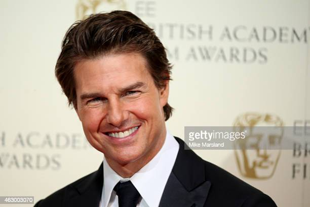 Actor Tom Cruise poses in the winners room at the EE British Academy Film Awards at The Royal Opera House on February 8 2015 in London England
