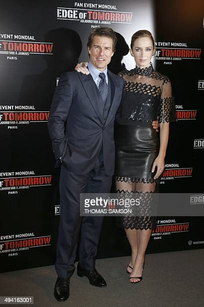 US actor Tom Cruise poses with British actress Emily Blunt at the premiere of the film 'Edge of Tomorrow' in Paris on May 28 2014 AFP PHOTO / THOMAS...