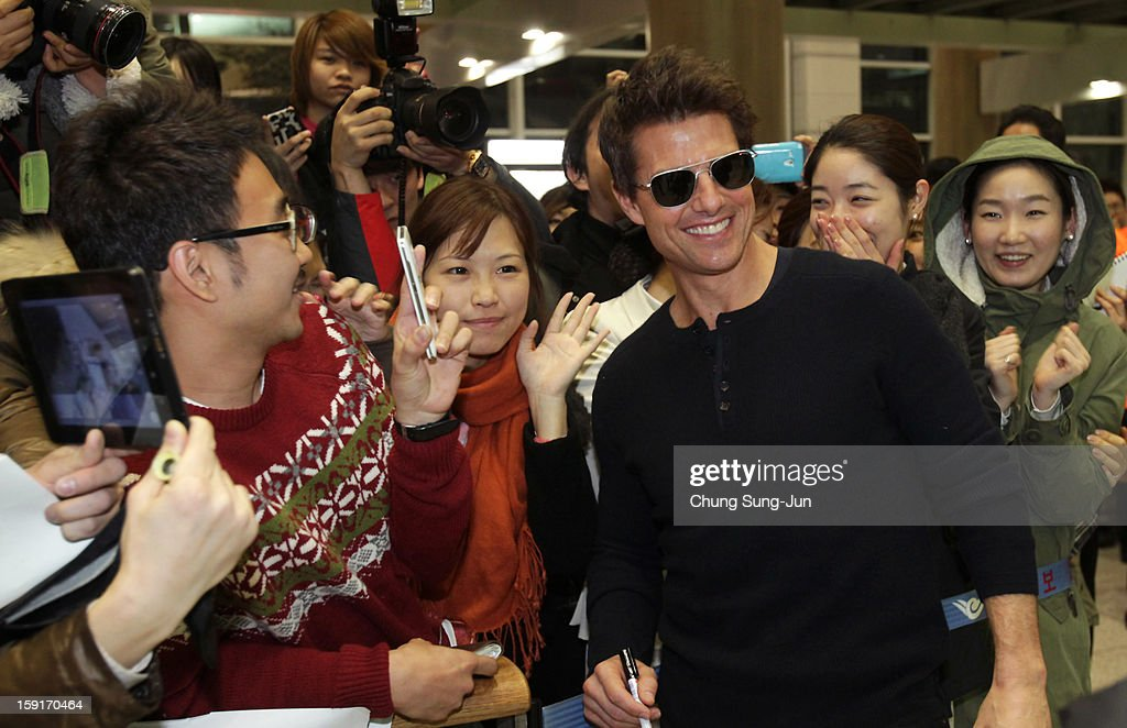 Actor <a gi-track='captionPersonalityLinkClicked' href=/galleries/search?phrase=Tom+Cruise&family=editorial&specificpeople=156405 ng-click='$event.stopPropagation()'>Tom Cruise</a> poses with fans as he arrives at Incheon International Airport on January 9, 2013 in Incheon, South Korea.