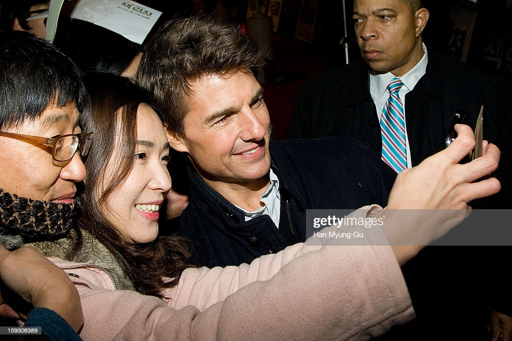Actor Tom Cruise poses with fans as he arrives at the 'Jack Reacher' Fan Screening at Busan Cinema Center on January 10, 2013 in Busan, South Korea. The film will open on January 17 in South Korea.