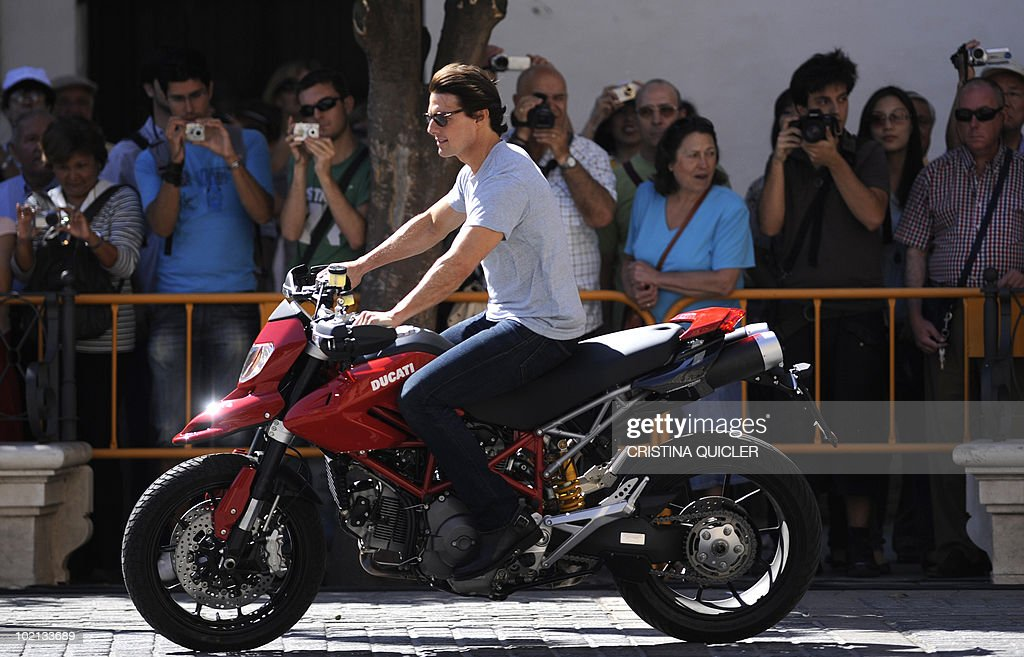 US actor Tom Cruise rides a bike in Sevilla on June 16, 2010, to recreate scenes from the film 'Knight and Day' by US director James Mangold. US actors Tom Cruise and Cameron Diaz are in Sevilla to attend the international premiere of Mangold's new film.