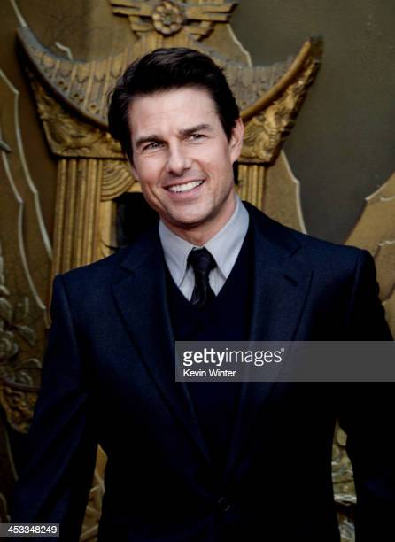 Actor Tom Cruise speaks as actor Ben Stiller is honored with a hand and footprint ceremony at the TCL Chinese Theatre on December 3 2013 in Los...
