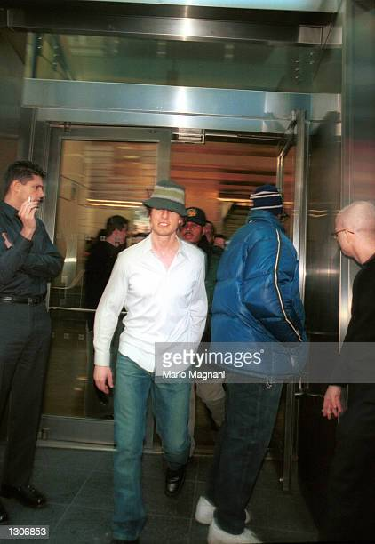 Actor Tom Cruise tries to look inconspicuous in Time''s Square outside the Conde Nast Building November 29 2000 in New York City