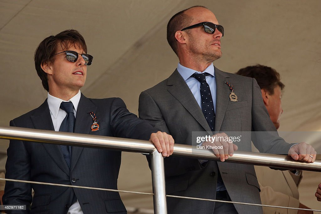 Actor <a gi-track='captionPersonalityLinkClicked' href=/galleries/search?phrase=Tom+Cruise&family=editorial&specificpeople=156405 ng-click='$event.stopPropagation()'>Tom Cruise</a> watches the racing at Goodwood on July 31, 2014 in Chichester, England. Today is Ladies Day at the prestigious Goodwood Races.