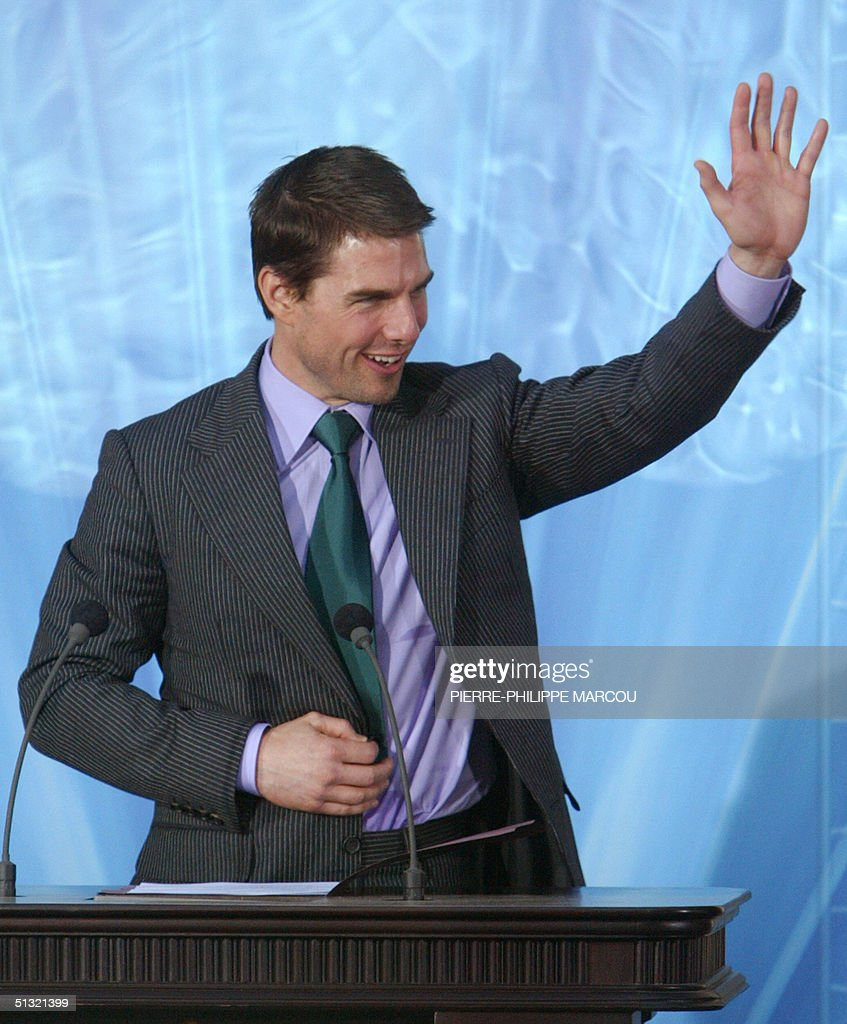 US actor Tom Cruise waves during the inauguration of the Church of Scientology in Madrid 18 September 2004 AFP PHOTO/ PierrePhilippe MARCOU