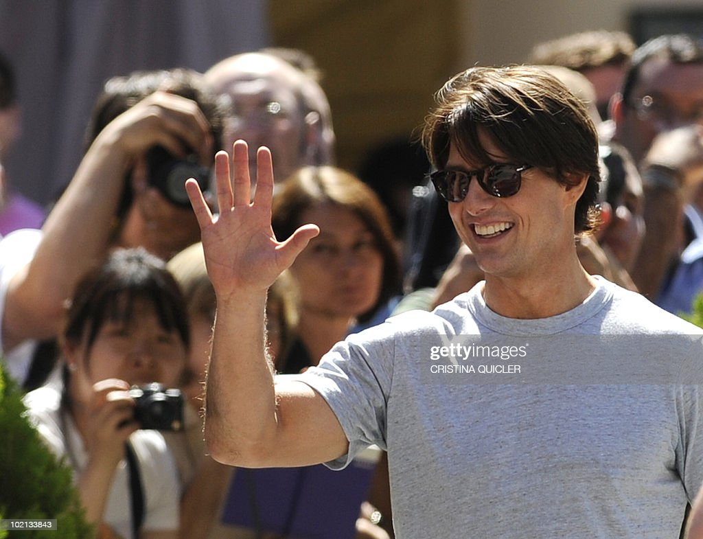US actor Tom Cruise waves to fans after riding a bike in Sevilla on June 16, 2010 to recreate scenes from the film 'Knight and Day' by US director James Mangold. US actors Tom Cruise and Cameron Diaz are in Sevilla to attend the international premiere of Mangold's new film.