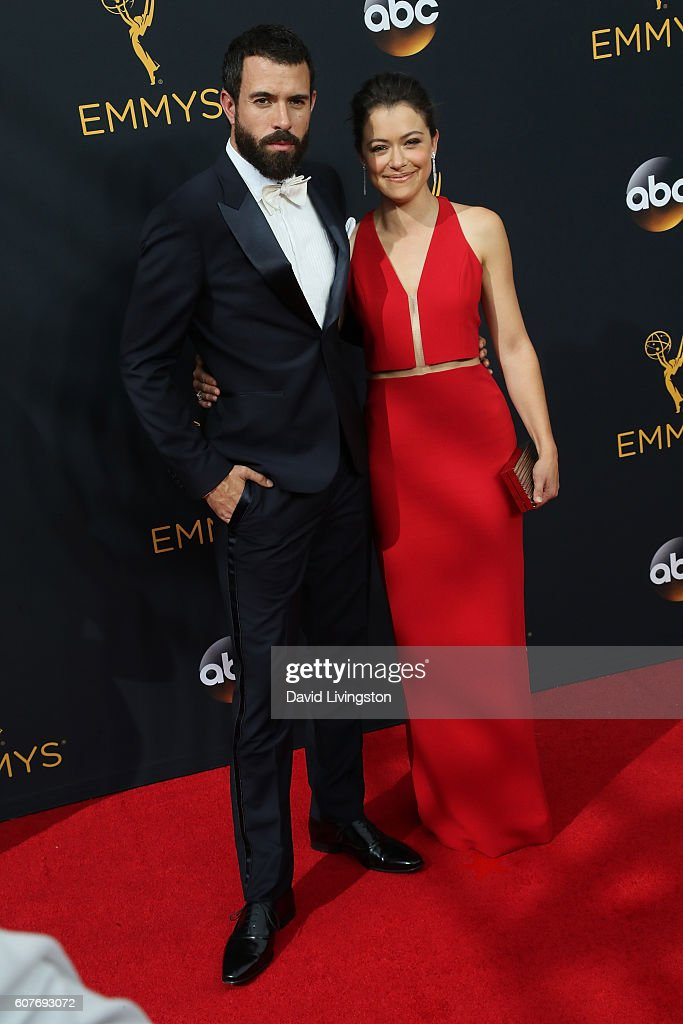 Actor Tom Cullen (L) and actress Tatiana Maslany arrive at the 68th Annual Primetime Emmy Awards at the Microsoft Theater on September 18, 2016 in Los Angeles, California.