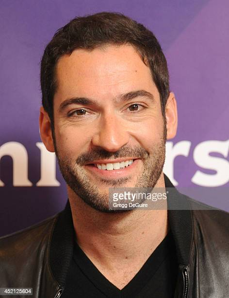 Actor Tom Ellis arrives at the 2014 Television Critics Association Summer Press Tour NBCUniversal Day 1 at The Beverly Hilton Hotel on July 13 2014...
