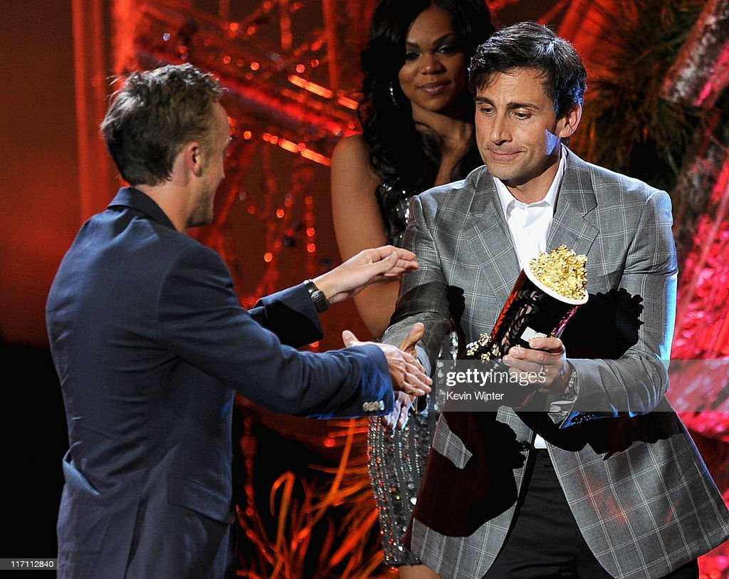 Actor <a gi-track='captionPersonalityLinkClicked' href=/galleries/search?phrase=Tom+Felton&family=editorial&specificpeople=2166394 ng-click='$event.stopPropagation()'>Tom Felton</a> (L) accepts the Best Villain award from actor <a gi-track='captionPersonalityLinkClicked' href=/galleries/search?phrase=Steve+Carell&family=editorial&specificpeople=595491 ng-click='$event.stopPropagation()'>Steve Carell</a> onstage during the 2011 MTV Movie Awards at Universal Studios' Gibson Amphitheatre on June 5, 2011 in Universal City, California.