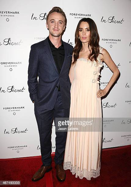 Actor Tom Felton and actress Jade Gordon attend the premiere of 'In Secret' at ArcLight Hollywood on February 6 2014 in Hollywood California