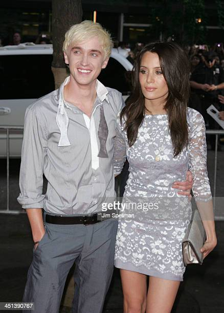 Actor Tom Felton and guest attend the Harry Potter and the HalfBlood Prince premiere at Ziegfeld Theatre on July 9 2009 in New York City