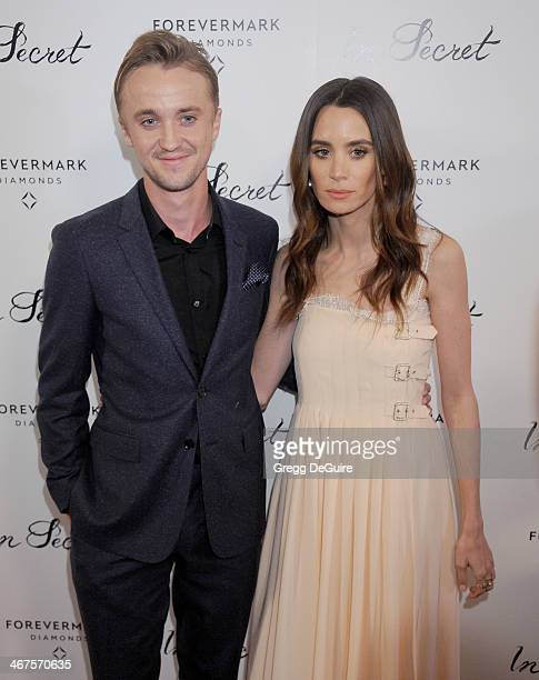 Actor Tom Felton and Jade Olivia arrive at the Los Angeles premiere of 'In Secret' at ArcLight Hollywood on February 6 2014 in Hollywood California