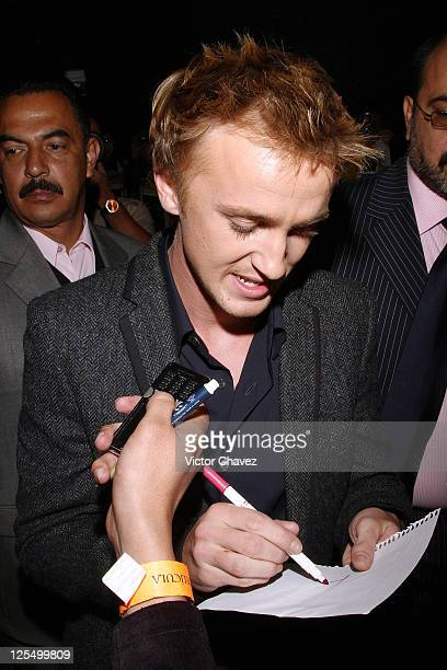 Actor Tom Felton signs autographs to fans during the 'Harry Potter and The Deathly Hallows Part 1' premiere at the Hipodromo De Las Americas on...