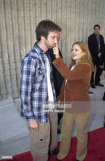 Actor Tom Green gets his nose picked by fiance Drew Barrymore at the at the premiere of 'Loser' July 20 2000 at the Avco Cinema Theater in Westwood CA