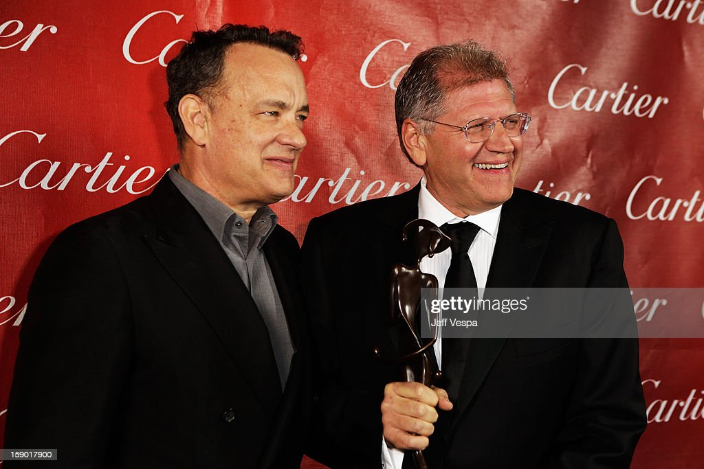 Actor Tom Hanks and director Robert Zemeckis pose with the Director of the Year Award at the 24th annual Palm Springs International Film Festival Awards Gala at the Palm Springs Convention Center on January 5, 2013 in Palm Springs, California.