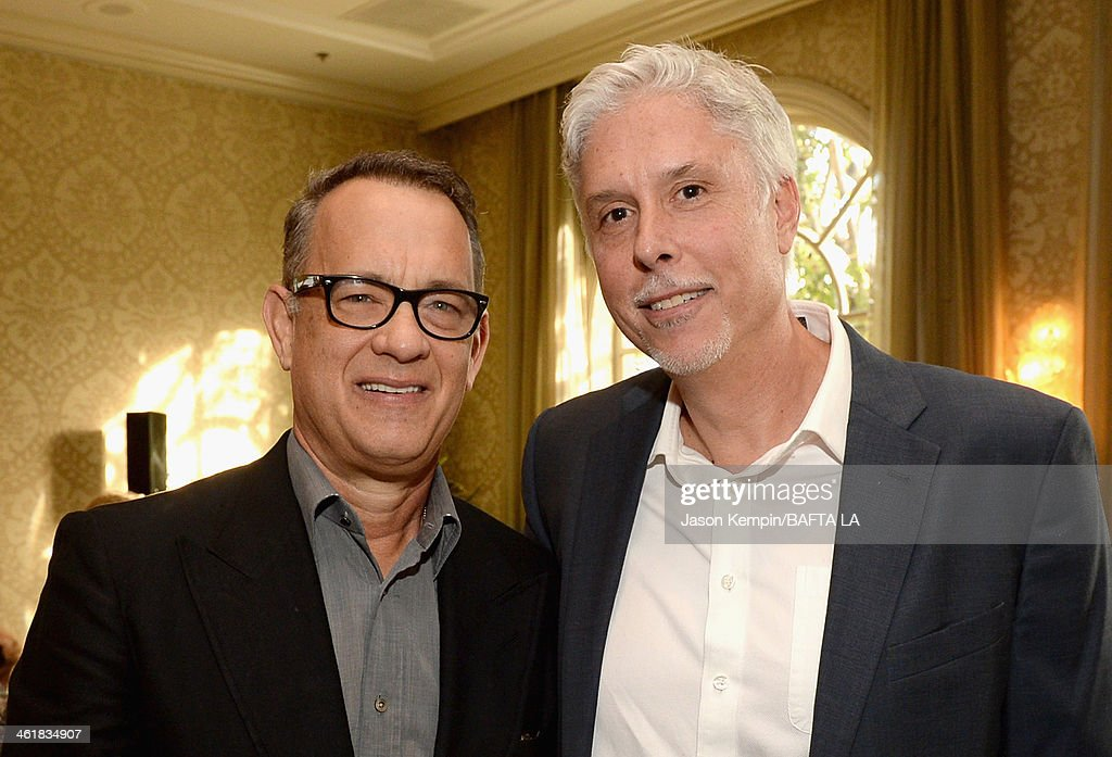 Actor <a gi-track='captionPersonalityLinkClicked' href=/galleries/search?phrase=Tom+Hanks&family=editorial&specificpeople=201790 ng-click='$event.stopPropagation()'>Tom Hanks</a> and editor <a gi-track='captionPersonalityLinkClicked' href=/galleries/search?phrase=Christopher+Rouse&family=editorial&specificpeople=4159557 ng-click='$event.stopPropagation()'>Christopher Rouse</a> attend the BAFTA LA 2014 Awards Season Tea Party at the Four Seasons Hotel Los Angeles at Beverly Hills on January 11, 2014 in Beverly Hills, California.