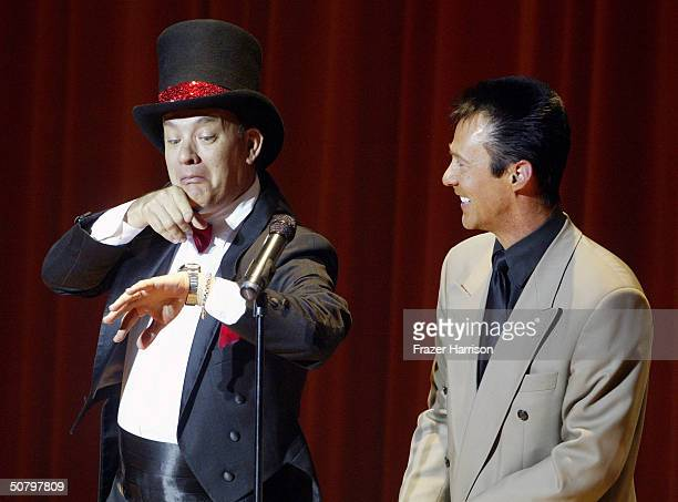 Actor Tom Hanks and magician Lance Burton perform on stage at the 'weSparkle Night Take III Benefit at the Gindi Theatre on May 3 2004 in Bel Air...
