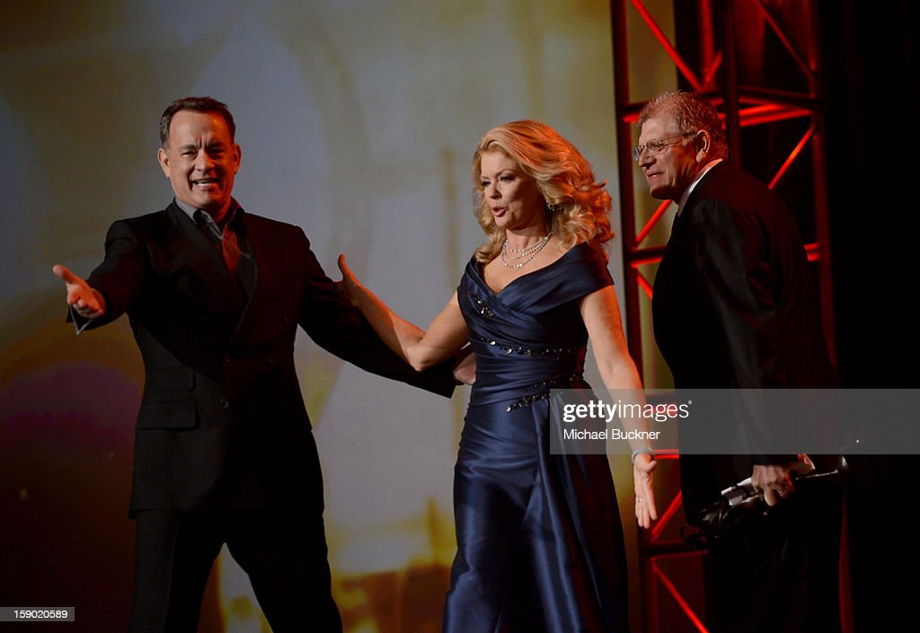 Actor Tom Hanks and TV personality Mary Hart speak onstage during the 24th annual Palm Springs International Film Festival Awards Gala at the Palm Springs Convention Center on January 5, 2013 in Palm Springs, California.