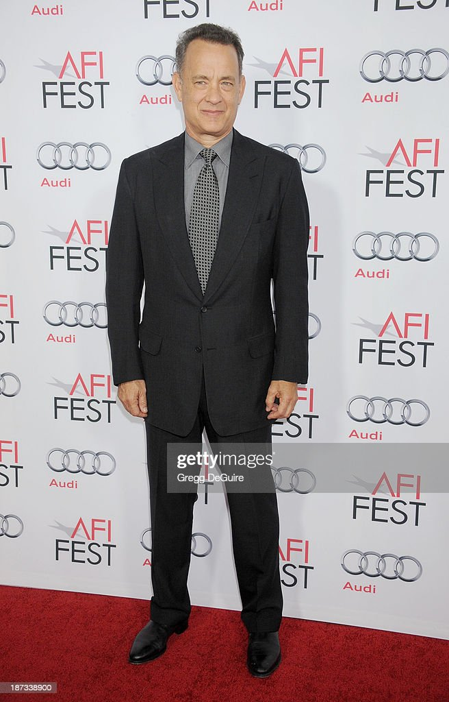Actor <a gi-track='captionPersonalityLinkClicked' href=/galleries/search?phrase=Tom+Hanks&family=editorial&specificpeople=201790 ng-click='$event.stopPropagation()'>Tom Hanks</a> arrives at AFI FEST 2013 Opening Night Gala premiere of 'Saving Mr. Banks' at TCL Chinese Theatre on November 7, 2013 in Hollywood, California.