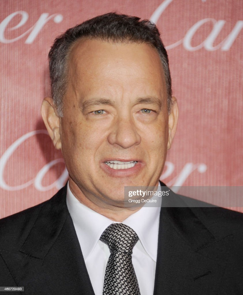 Actor <a gi-track='captionPersonalityLinkClicked' href=/galleries/search?phrase=Tom+Hanks&family=editorial&specificpeople=201790 ng-click='$event.stopPropagation()'>Tom Hanks</a> arrives at the 25th Annual Palm Springs International Film Festival Awards Gala at Palm Springs Convention Center on January 4, 2014 in Palm Springs, California.